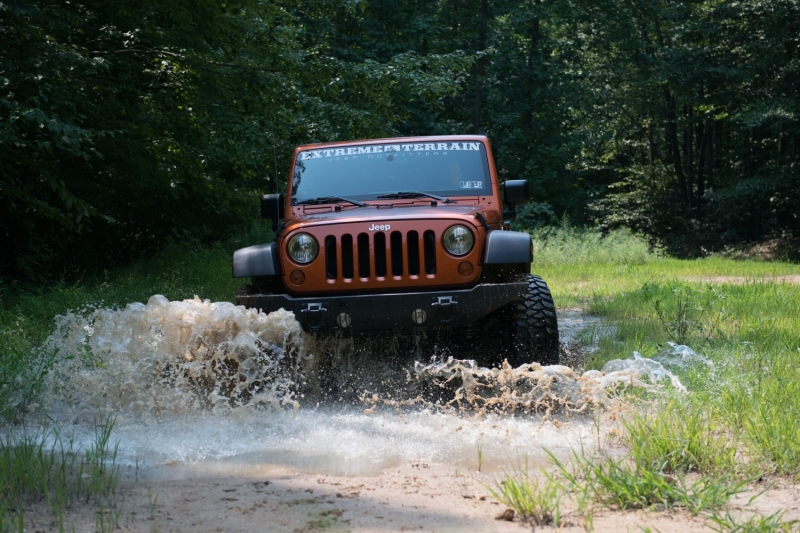 Wrangler Wheeling Through Mud